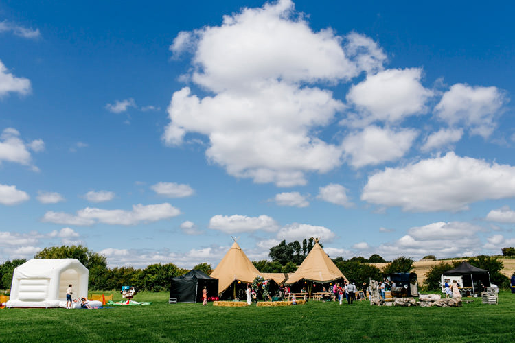 Tipi Glamping Bouncy Castle Bright Fun Festival Boho Wedding The Party Field East Sussex http://epiclovestory.co.uk/