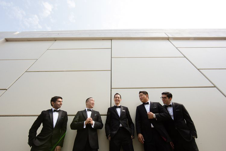 Groom Groomsmen Group Photo Bridge Hangar Building | Black Tie Carnival Wedding Hot Air Balloon http://www.makingthemoment.com/