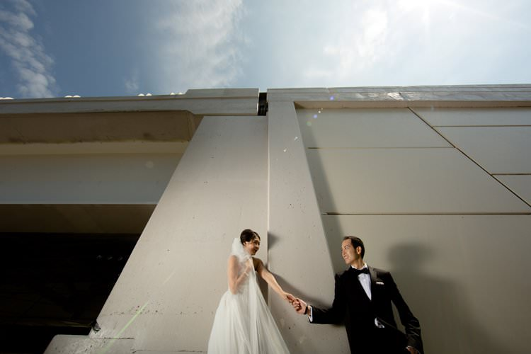 Bride Groom Photo Bridge Hangar White Building | Black Tie Carnival Wedding Hot Air Balloon http://www.makingthemoment.com/