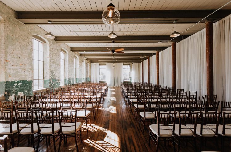 City Urban Georgia Engine Room Exposed Bricks Ceremony Aisle Brown Chiavari Chairs | Bohemian Industrial Oxblood Wedding https://www.lunaleephotos.com/