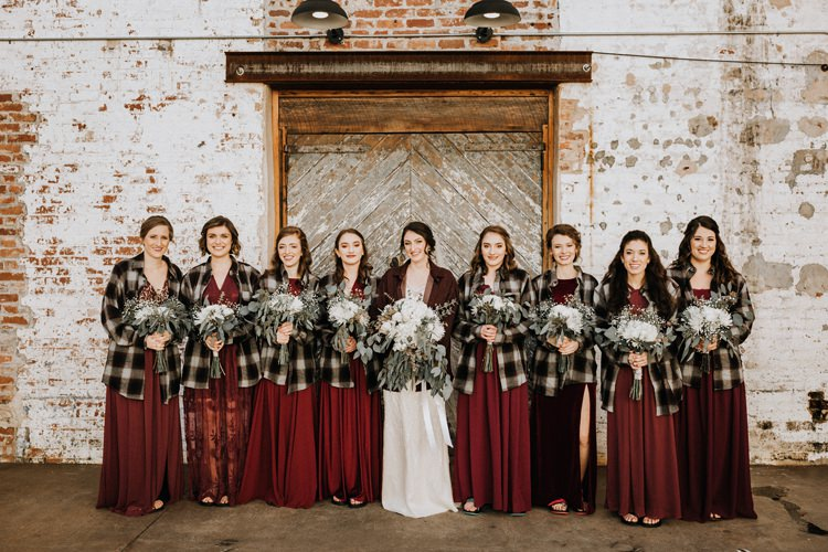 City Urban Georgia Engine Room Exposed Bricks Bride Burgundy Bridesmaids White Foliage Bouquet Chequered Shirts | Bohemian Industrial Oxblood Wedding https://www.lunaleephotos.com/