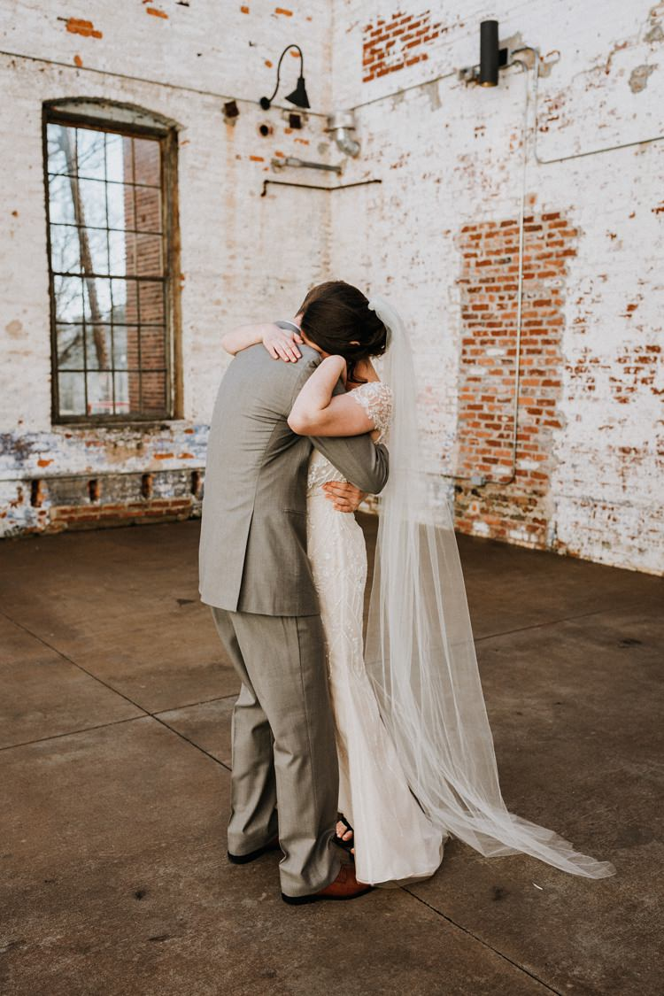 City Urban Georgia Engine Room Exposed Bricks Bride Groom Embrace First Look | Bohemian Industrial Oxblood Wedding https://www.lunaleephotos.com/