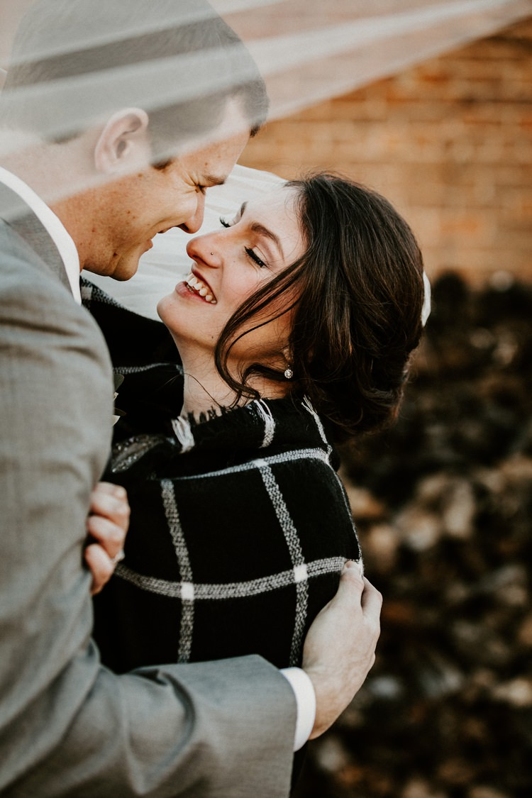 City Urban Georgia Engine Room Exposed Bricks Bride Groom Embrace First Look Blanket | Bohemian Industrial Oxblood Wedding https://www.lunaleephotos.com/
