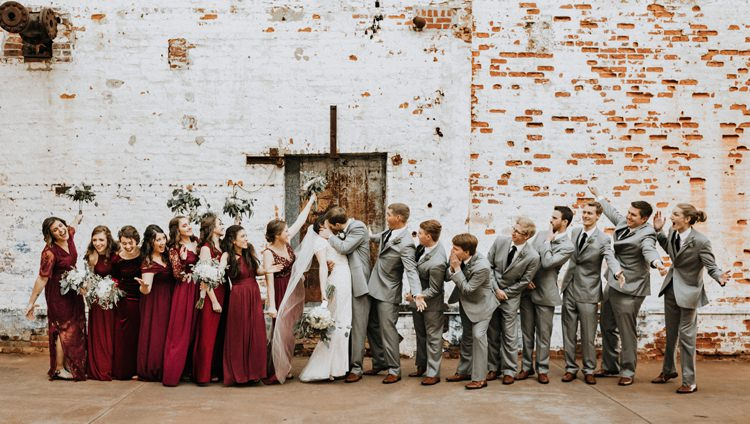 City Urban Georgia Engine Room Exposed Bricks Bridesmaids Groomsmen Bride Groom Kiss | Bohemian Industrial Oxblood Wedding https://www.lunaleephotos.com/