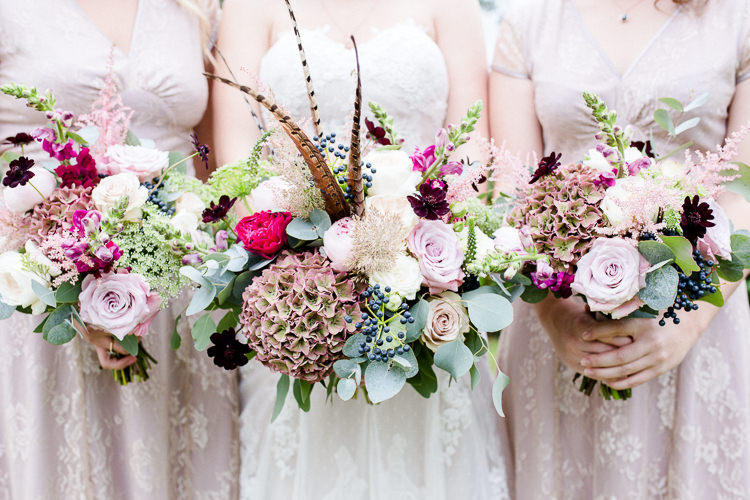 Bride Bridal Bridesmaids Bouquets Pheasant Feather Multicoloured Pink Rose Autumn Countryside Family Farm Wedding Dorset http://www.lydiastampsphotography.com/
