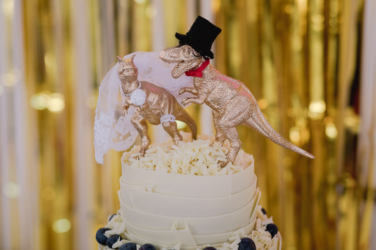 Gold Dinosaur Cake Topper Colourful Indie London City Wedding Clissold House West Reservoir Centre https://www.murrayclarke.co.uk/