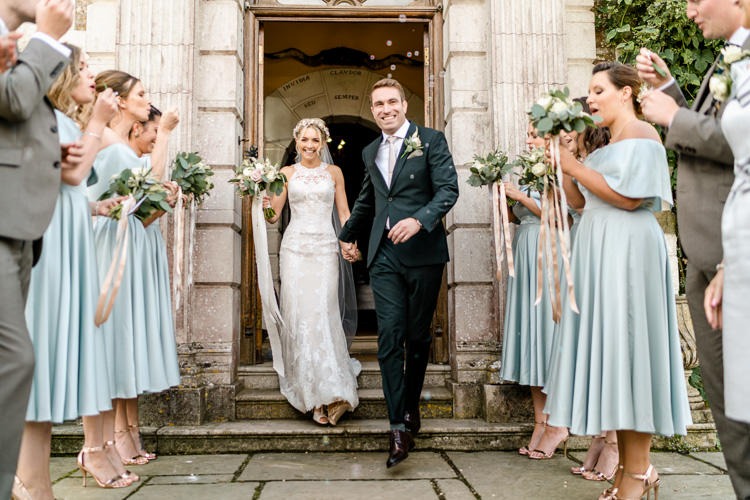Lace Keyhole Neck Fitted Pronovias Dress Gown Bride Bridal Faux Flower Crown Veil Bouquet Ribbon Reiss Bottle Green Suit Groom Tea Length Bridesmaids Off the Shoulder Bardot Nostalgic Honest British Loseley Park Wedding Surrey https://www.johnbarwoodphotography.co.uk/