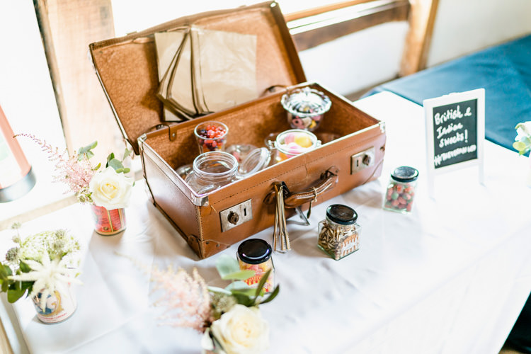 Sweet Station Vintage Suitcase Trunk Jars Table Nostalgic Honest British Loseley Park Wedding Surrey https://www.johnbarwoodphotography.co.uk/