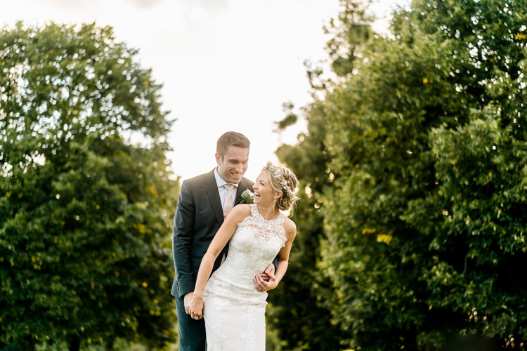 Lace Keyhole Neck Fitted Pronovias Dress Gown Bride Bridal Faux Flower Crown Veil Reiss Groom Bottle Green Suit Nostalgic Honest British Loseley Park Wedding Surrey https://www.johnbarwoodphotography.co.uk/