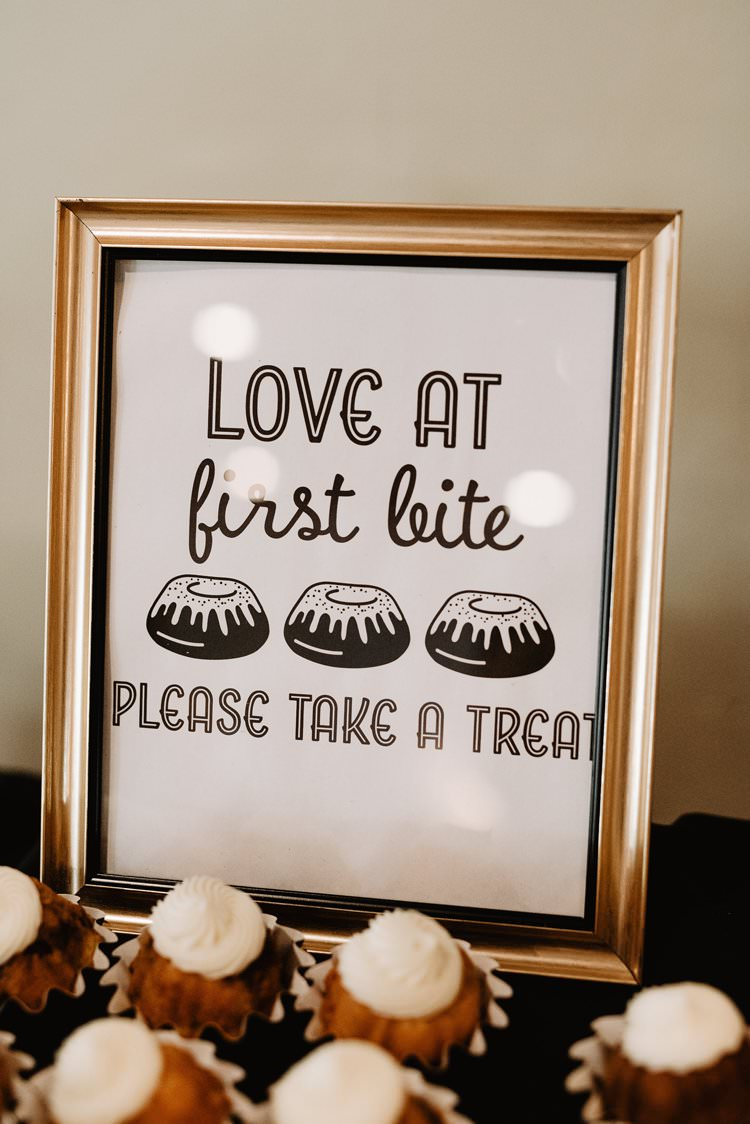 Love at First Bite Please Take a Treat Sign Gold Frame White Icing Cupcakes Dessert Table | Dreamy Blush Emerald Fairytale Wedding Oklahoma http://www.kelcyleighphotography.com