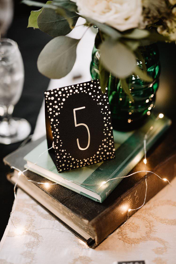 Book Fairylights Centrepiece Romantic Table Decor Number Sign Emerald Green | Dreamy Blush Emerald Fairytale Wedding Oklahoma http://www.kelcyleighphotography.com/