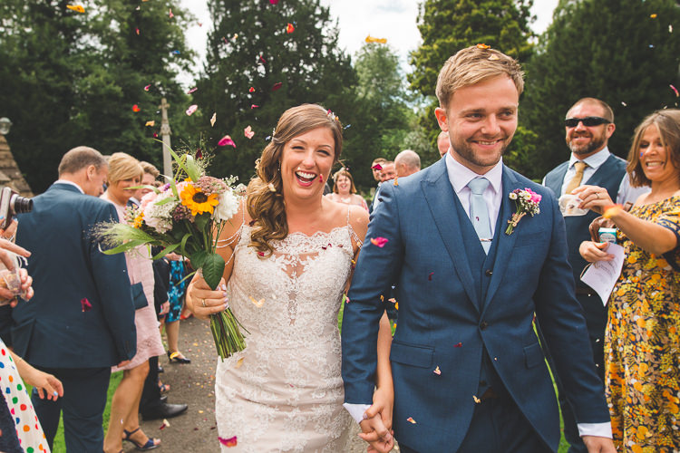 Bride Bridal Sottero & Midgeley Dress Gown Lace Shoulder Detail Richard James Suit Three Piece Waistcoat Blue Groom Confetti Sunflower Bouquet Colourful Outdoor Tipi Farm Wedding https://kirstymackenziephotography.co.uk/