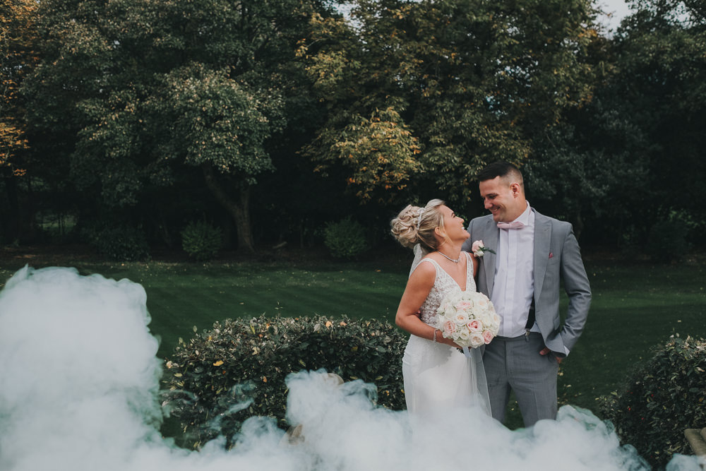 Bride Groom Happy Laughter Classic Traditional Bouquet Bridal Updo Grey Suit White Smoke Bomb | Ashfield House Wedding Kate McCarthy Photography