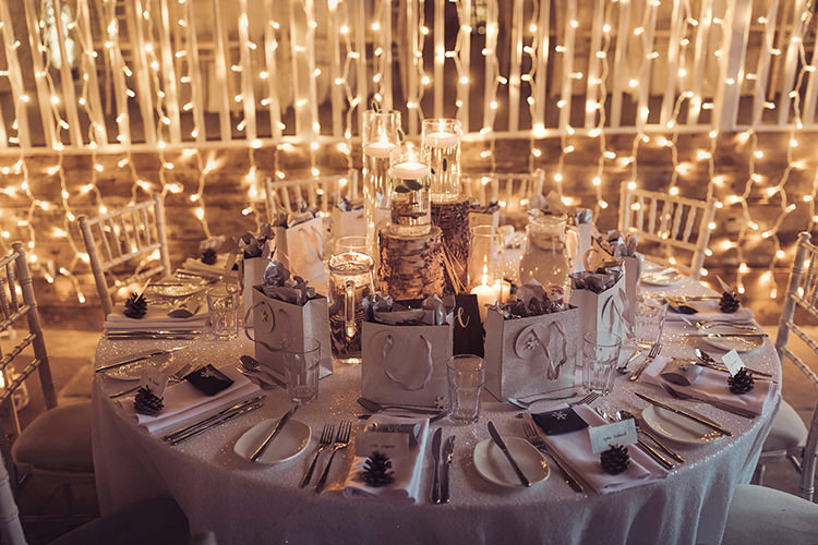 Table Setting Wood Slice Log Gift Bag Pea Fairy Light Magical Wonderland Askham Hall Wedding Winter Tiree Dawson Photography
