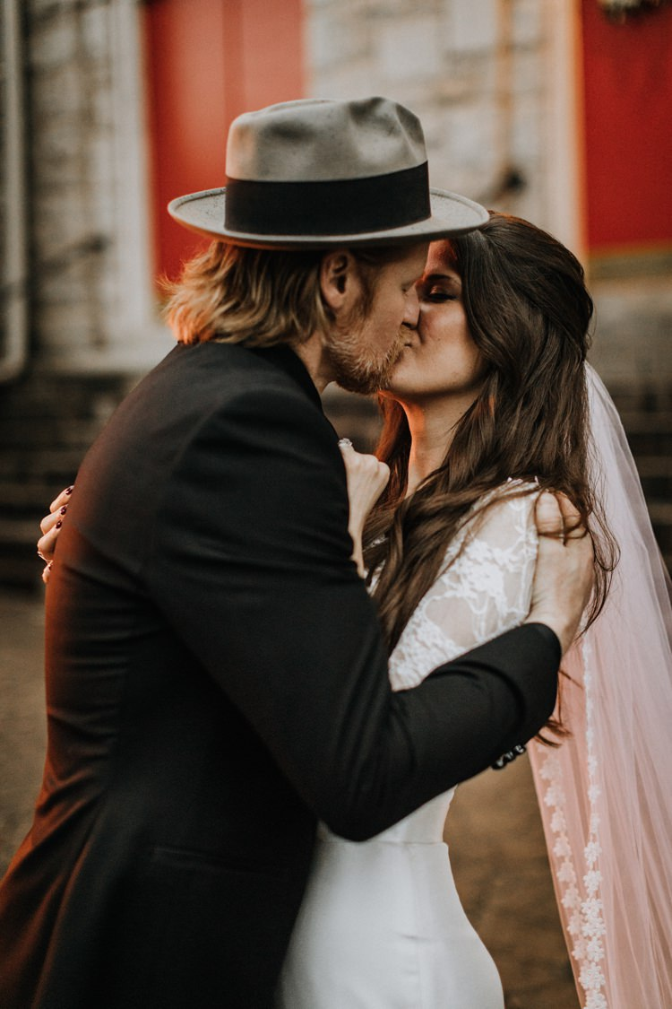 Warehouse Rustic Chic Refined Street Photography Groom Bride Kiss | Boho Industrial Winter Wedding Lunalee Photography