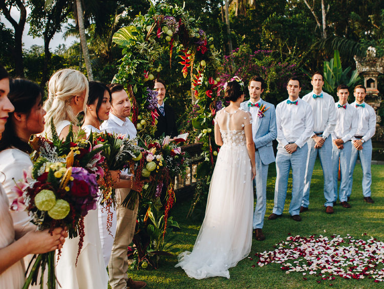 Outdoor Destination Luxury Adventure Ubud Ceremony Bride Colorful Bouquet Tropical Floral Arch | Whimsical Exotic Tropical Jungle Wedding Bali http://www.cecilephotographybali.com/