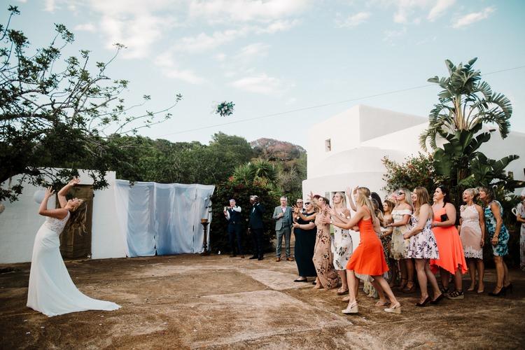 Spain Sun Outdoor Tropical Mediterranean Garden Villa Bride Bouquet Toss | Ibiza Destination Wedding Amy Faith Photography