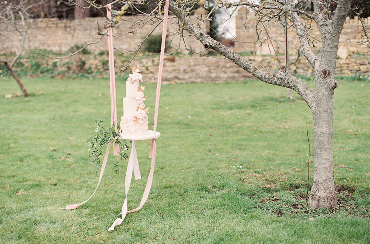 Blush Pink Gold Flower Cake Ribbon Swing Table Stand Whimsical Summer Chocolat Wedding Ideas Brympton House Liz Baker Fine Art Photography