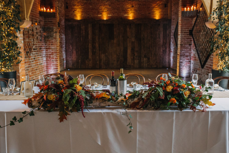 Top Table Foliage Flowers Florals Autumn Red Orange Shustoke Farm Barns Wedding Ellie Grace Photography