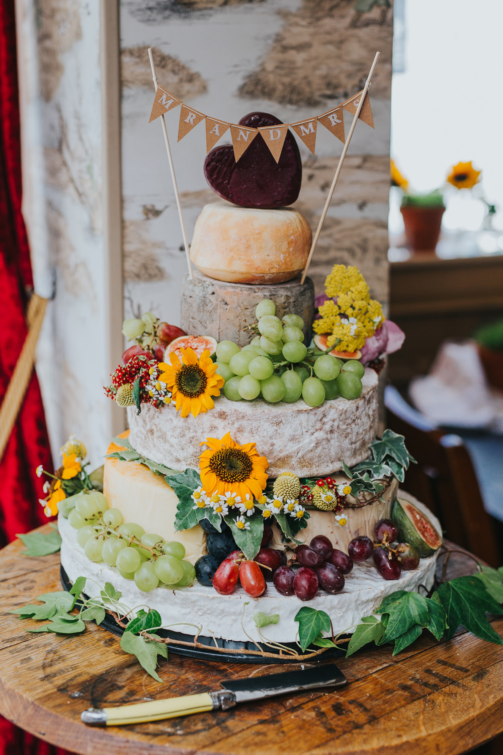 Cheese Tower Stack Cake Bunting Flowers Fruit Colourful Bright Summer Pub Wedding Charlotte Razzell Photography