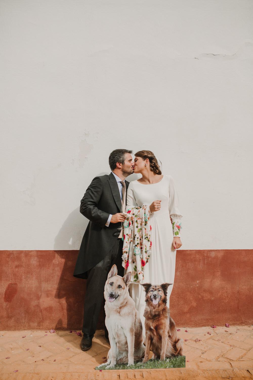 Outdoor Seville Destination Villa Hacienda Bride Groom Kiss Colorful Floral Dress Dog Cutout | Colorful and Heartfelt Wedding in Spain Boda&Films
