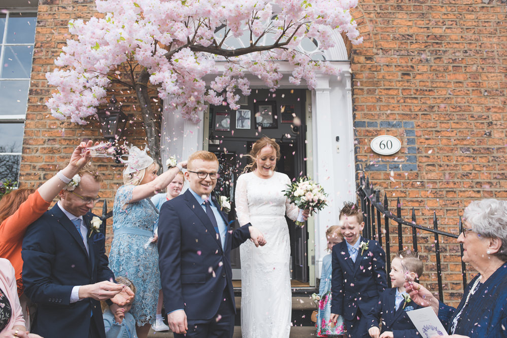 Bride Bridal Lace Long Sleeve Savannah Miller Dress Gown Navy Hugo Boss Groom Pink Rose Bouquet Blossom Tree Confetti Real Petals 60 Hope Street Wedding Lisa Howard Photography