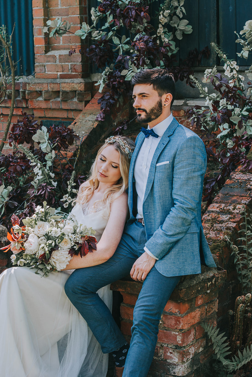 Secret Dresshouse Ethereal Bride Bridal Gown Blue Linen Jacket Bow Tie Groom Leaf Foliage Flower Florals River Romance Wedding Ideas Mindy Coe Photography