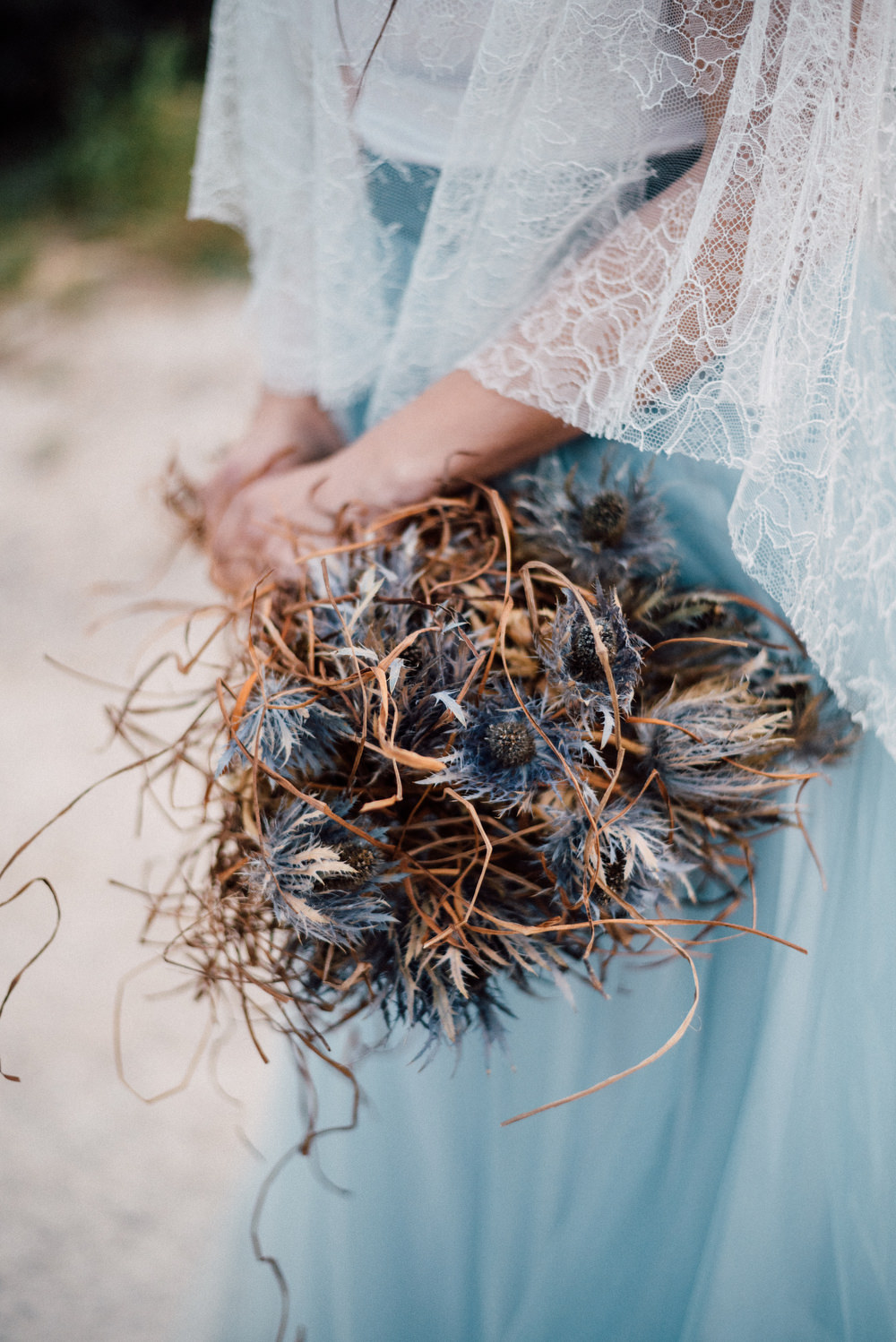 Outdoor Wild Nature Destination Spain Europe Sea Beach Styled Shoot Bride Blue Gown Lace Sea Holly Bouquet   Blue Ibiza Elopement Ideas and Surprise Proposal Serena Genovese Photography
