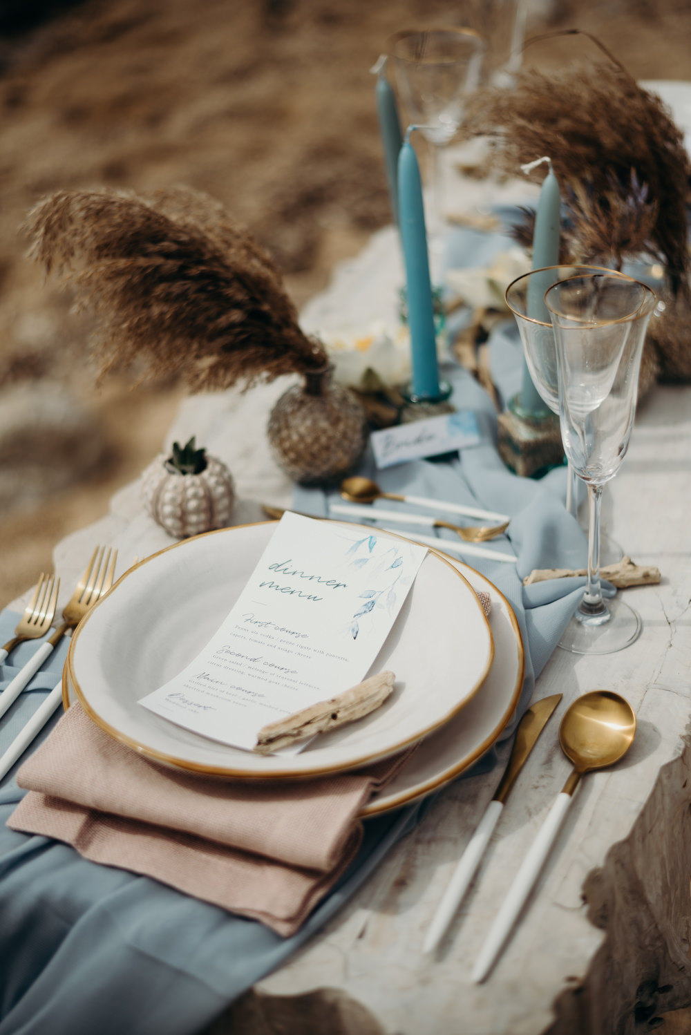 Outdoor Wild Nature Destination Spain Europe Coastal Styled Shoot Beach Table Elegant Styling Menu Candles Cutlery   Blue Ibiza Elopement Ideas and Surprise Proposal Serena Genovese Photography