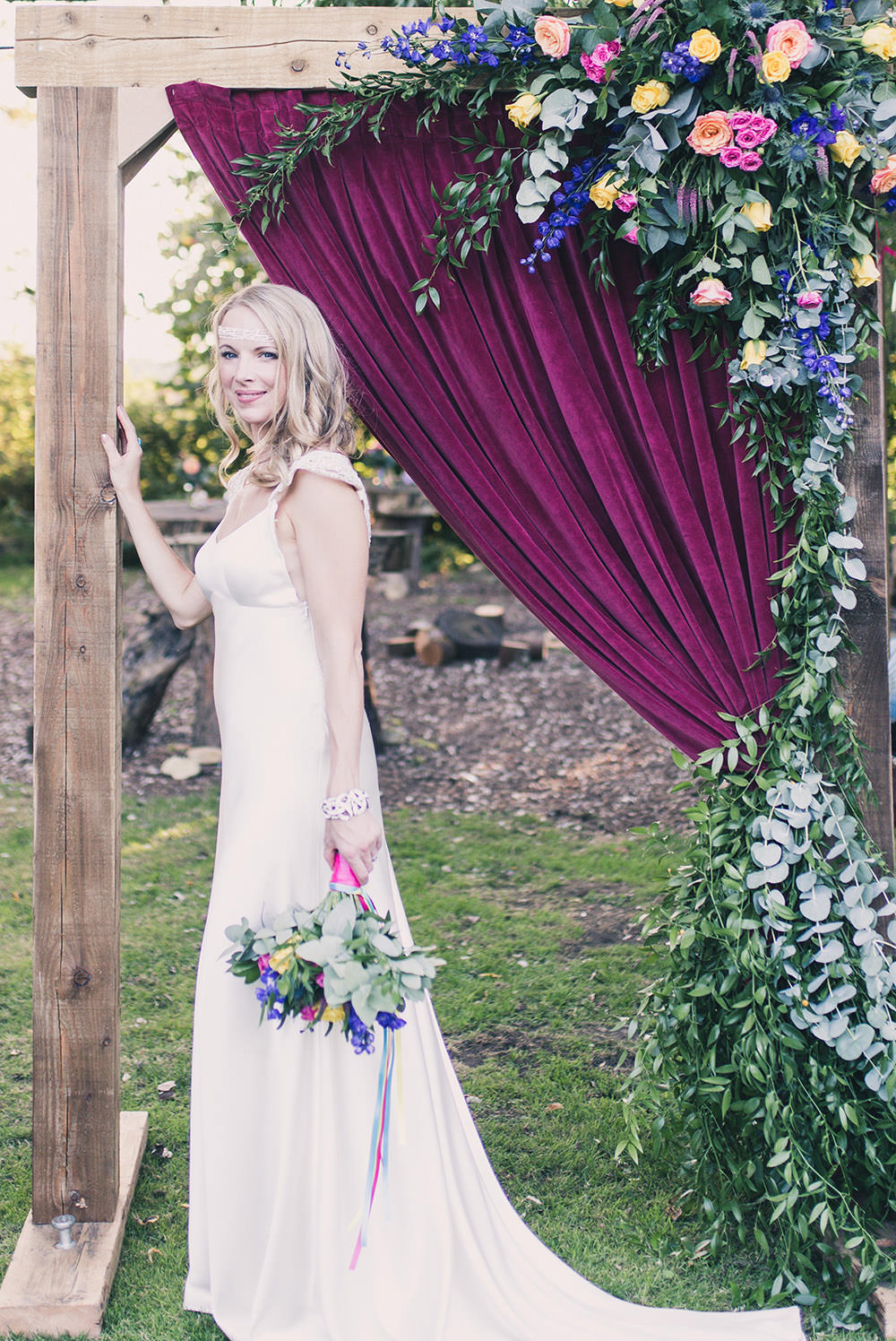 Flower Arch Florals Wooden Frame Multi Colour Colourful Backdrop Hothorpe Hall Woodlands Wedding Lucy Long Photography