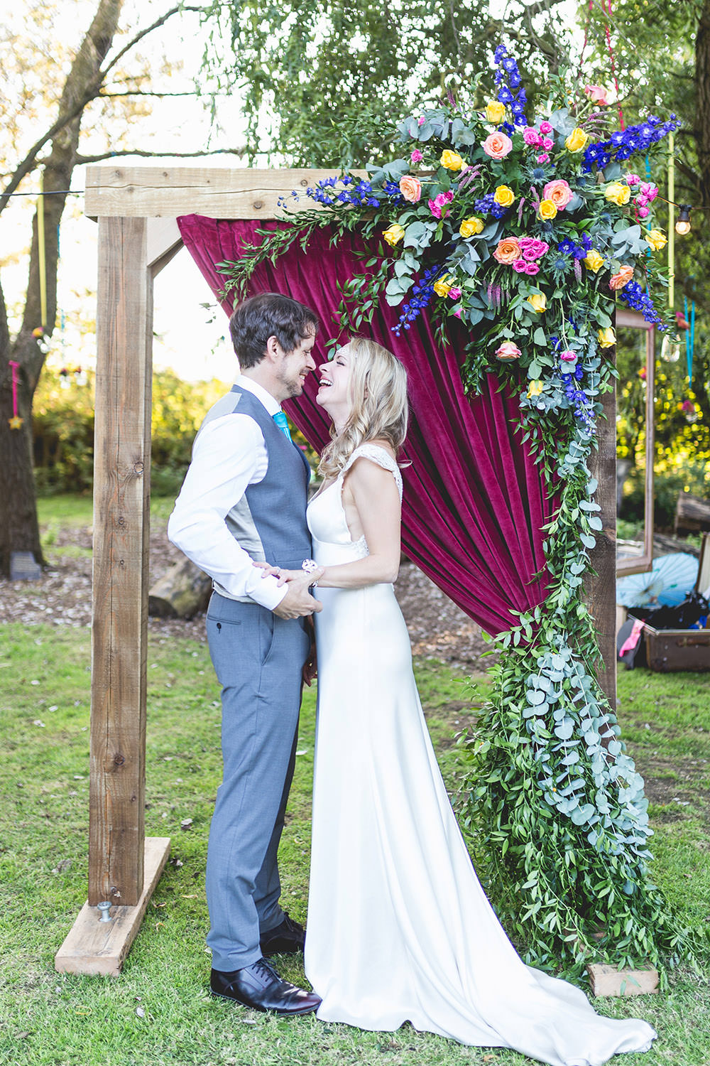 Hothorpe Hall Woodlands Wedding Lucy Long Photography Flower Arch Florals Wooden Frame Multi Colour Colourful Backdrop