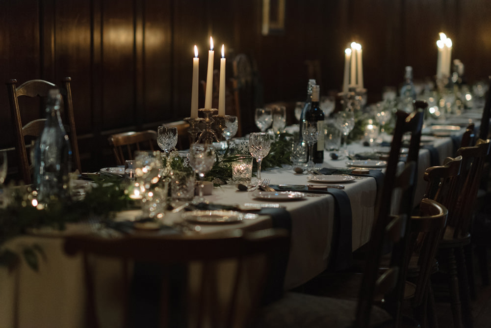 Forest Trees Castle Loch Simple Decor Greenery Fairy Lights Garland Runner Table Blue White | Intimate Winter Outdoor Scotland Wedding Christopher Ian Photography