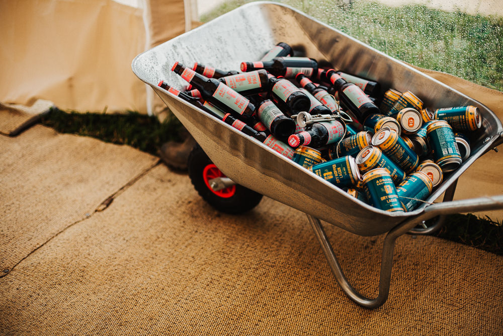 Drinks Wheelbarrow Beers Whimsical Countryside Sperry Tent Wedding Emilie May Photography