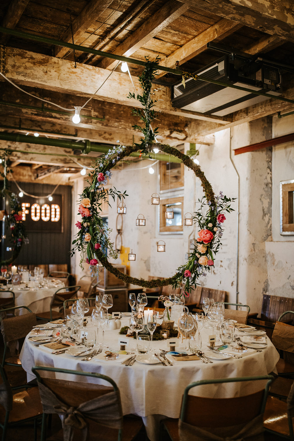 Suspended Hanging Centrepiece Hoop Circle Log Stand Flowers Moss Woodland Floral Peach Peony Coral Rose Candles Holmes Mill Wedding Emilie May Photography