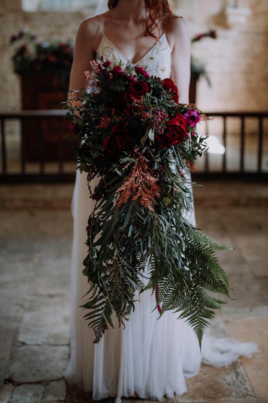 Bouquet Flowers Bride Bridal Large Cascading Oversized Greenery Foliage Burgundy Peony Peonies Ferns Industrial Luxe Wedding Ideas Balloon Installation Ayelle Photography