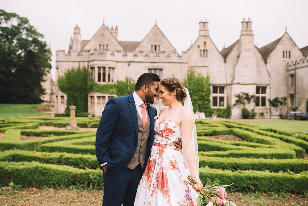 Groom Suit Waistcoat Coral Tie Navy Irnham Hall Wedding Lucie Watson Photography