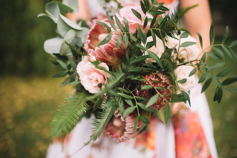 Bride Bridal Bouquet Flowers Greenery Foliage Large Protea Wild Whimsical Natural Fern Irnham Hall Wedding Lucie Watson Photography