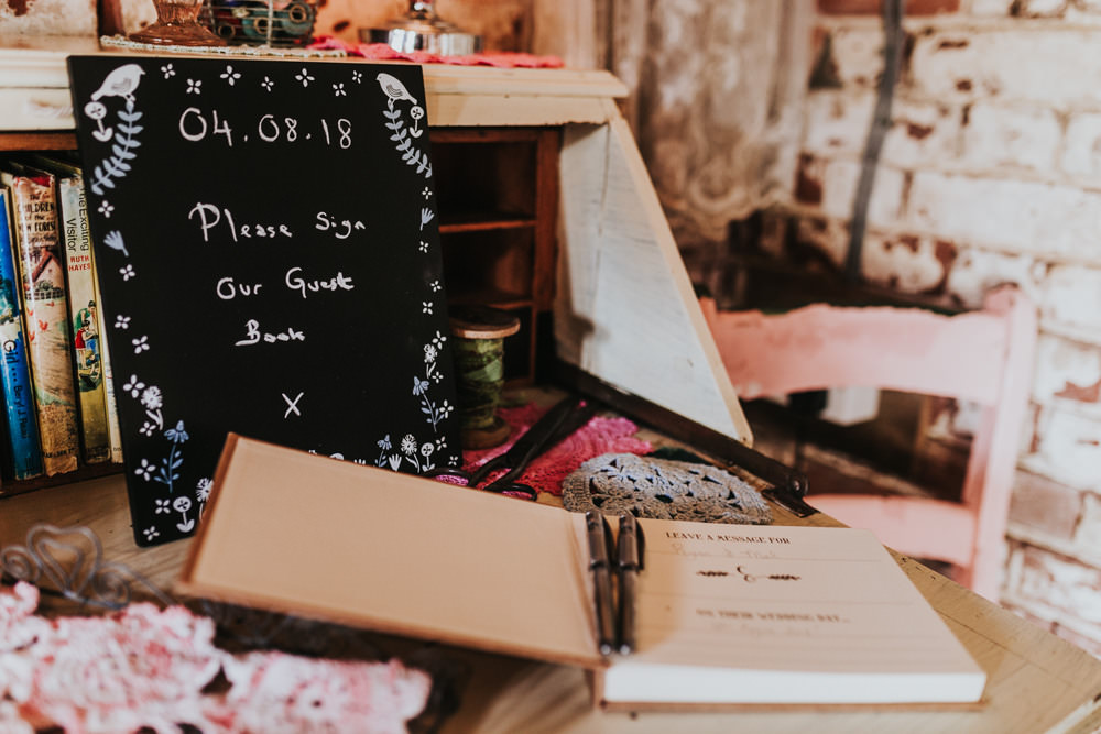 Keeper and The Dell Boho Farm Field Marquee DIY Alternative Rustic Vintage Books Guestbook Table Crochet | Relaxed Outdoor Wedding with 1000 Rainbow Origami Cranes Dan Biggins Photography