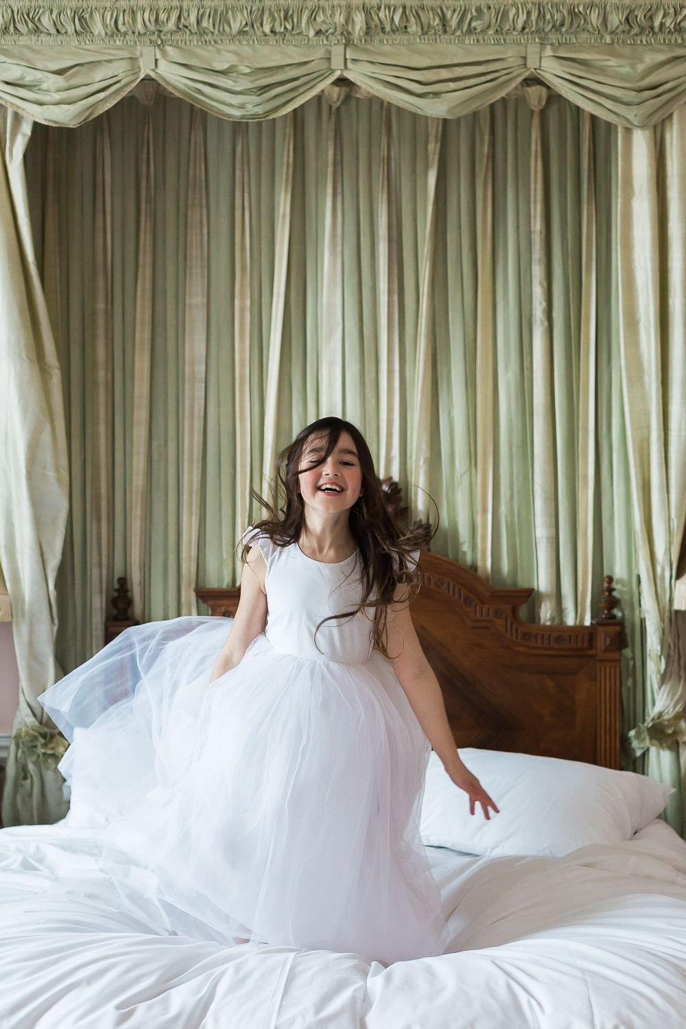 Modern Dance Ballet Inspired Fine Art Editorial Somerley House Morning Flower Girl Gilly Gray Jumping on Bed | Romantic Soft Wedding Ideas Siobhan H Photography