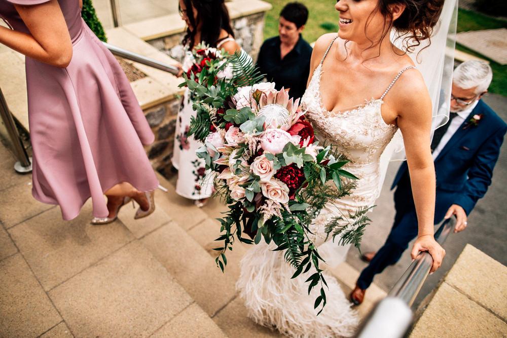 Bouquet Flowers Bride Bridal Red Pink Burgundy Protea Rose Asilbe Peony Fern Gamekeepers Inn Wedding Fairclough Studios