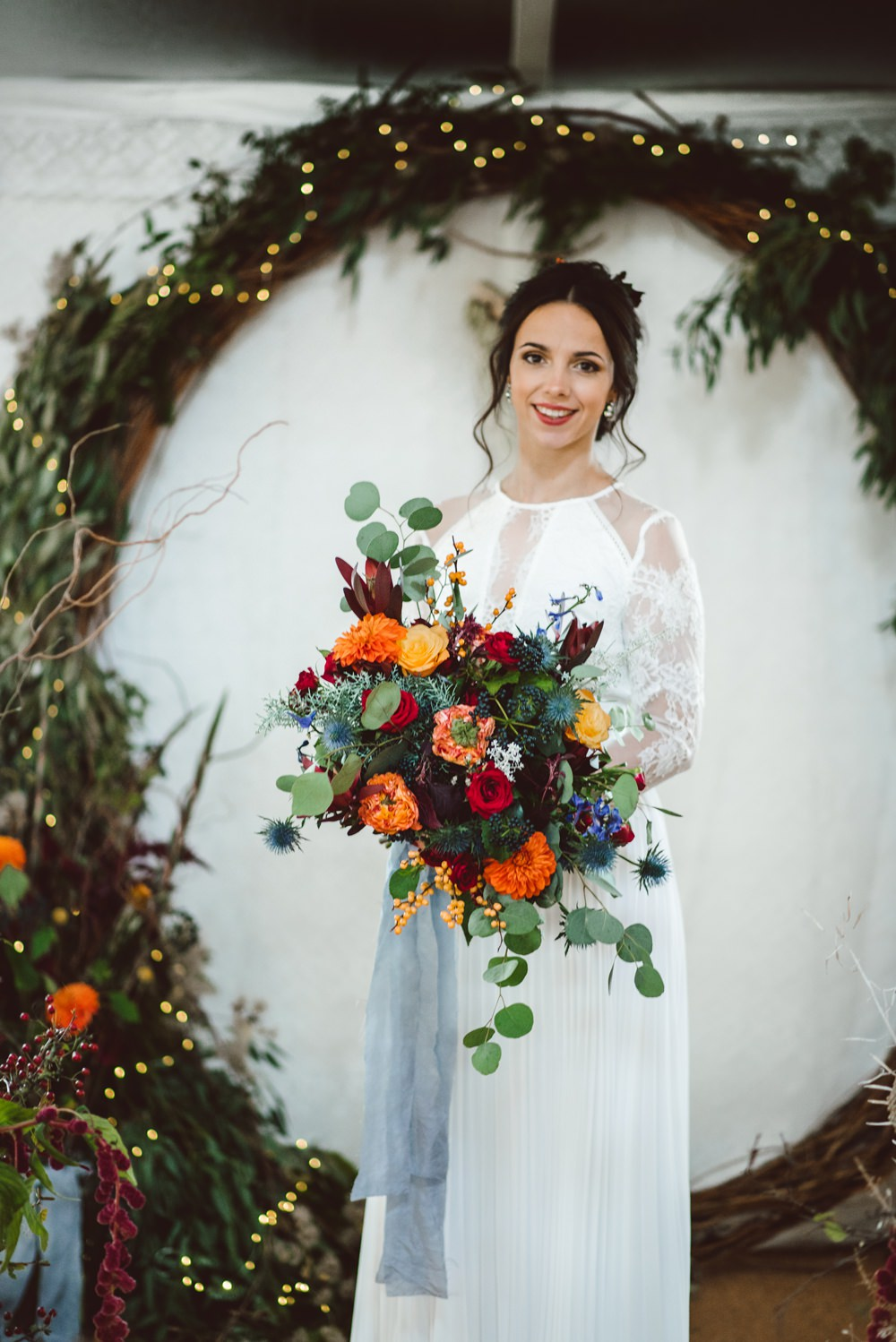 Moongate Flower Arch Backdrop Ceremony Conifer Eucalyptus Greenery Foliage Bride Bridal Dress Gown Lace Sleeves Illusion Rustic Christmas Wedding Ideas Dhw Photography