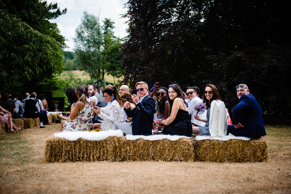 Hay Bales Seating Outdoor Ceremony West Lexham Wedding James Powell Photography