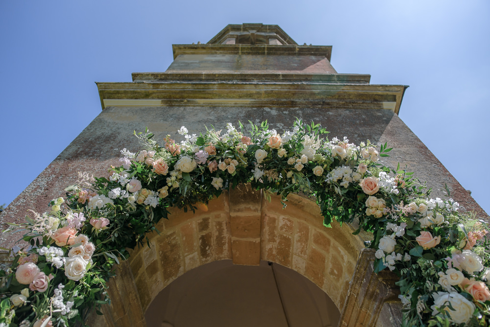 Flowers Floral Greenery Archway Entrance Babington House Wedding Ria Mishaal Photography