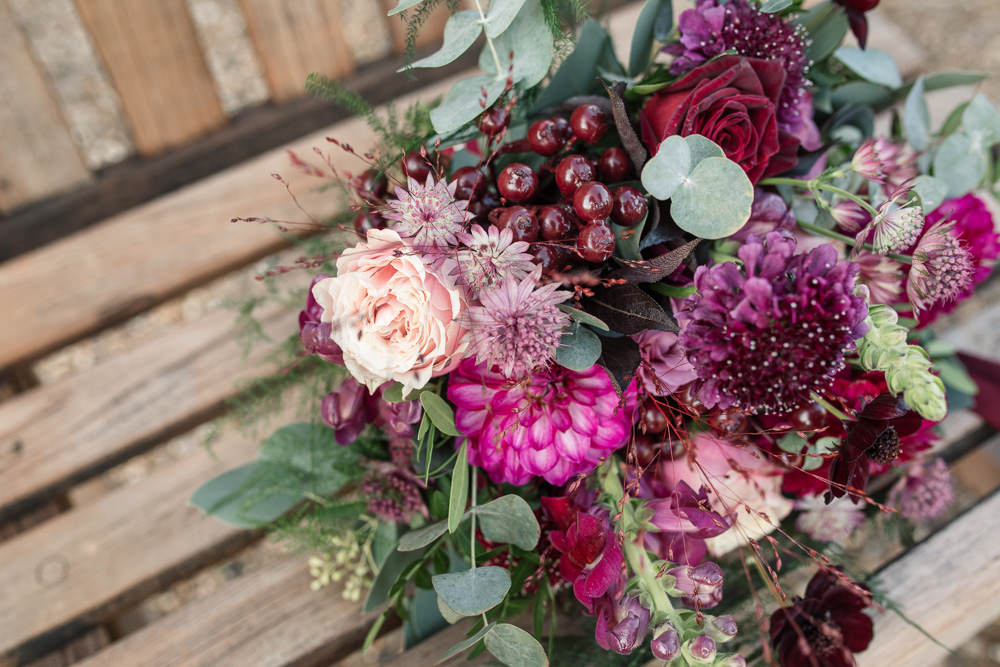 Bouquet Flowers Bride Bridal Red Pink Burgundy Green Greenery Foliage Berry Rose Ribbon Winter Luxe Wedding Ideas Becky Harley Photography