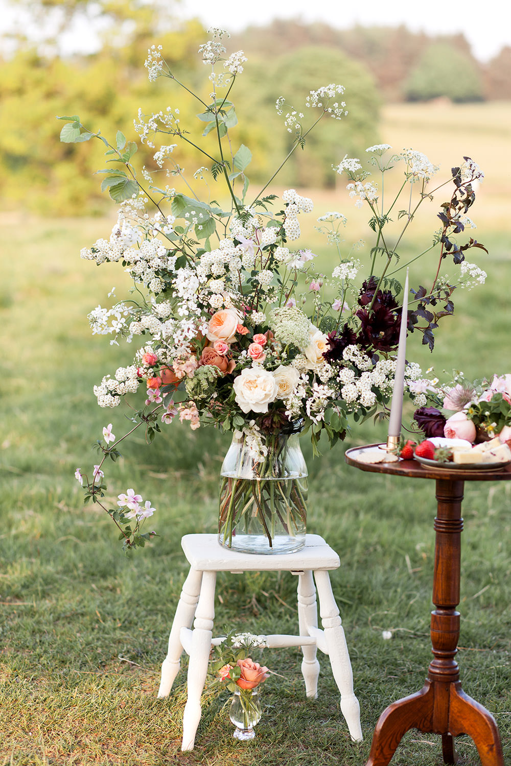 Table Flowers Peach Coral Cream Roses Greenery Foliage Large Vase Tall Light Airy Summer Wedding Ideas Charlotte Palazzo Photography