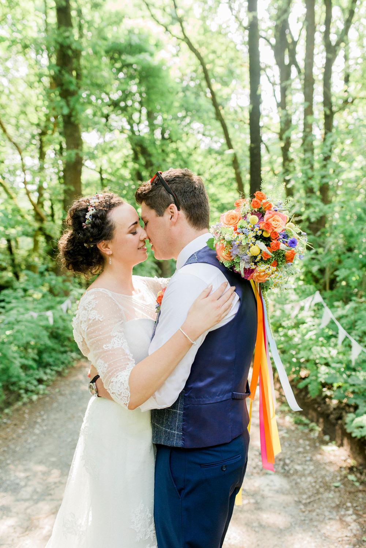 Bride Bridal Strapless Sweetheart Neckline Lace Jacket Sleeves Waistcoat Groom Blue Multicoloured Bouquet Ribbon Spring Cottage Rivington Wedding Emma B Photography