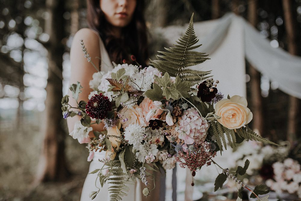 Bouquet Flowers Bride Bridal Wild Natural Whimsical Ribbons Foliage Greenery Hydrangea Berry Sweetpeas Ferns Rose Bohemian Woodland Wedding Ideas Lola Rose Photography