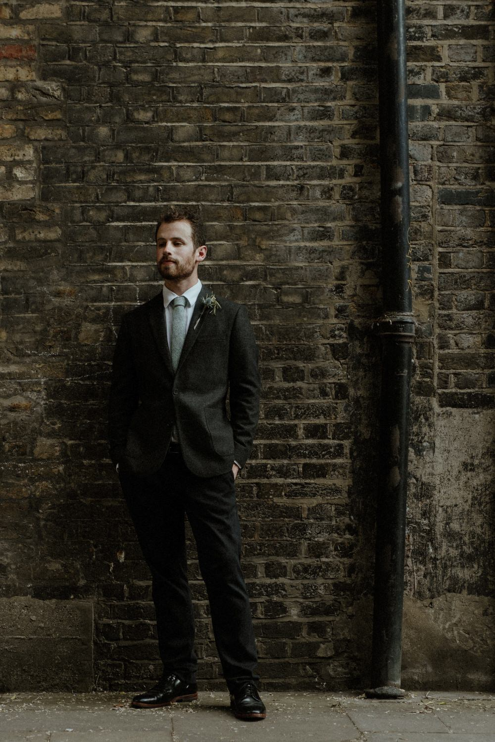 Groom Suit Charcoal Harris Tweed Suit Knitted Tie Thistle Buttonhole Brunel Museum Wedding Olivia and Dan Photography