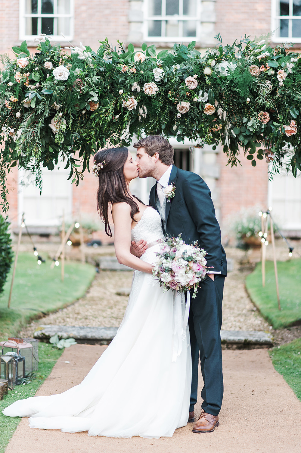 Bride Bridal Gown Dress Strapless Sweetheart Neckline Ribbon Belt Pink Blue Suit Groom Floral Foliage Arch Edmondsham House Wedding Darima Frampton Photography