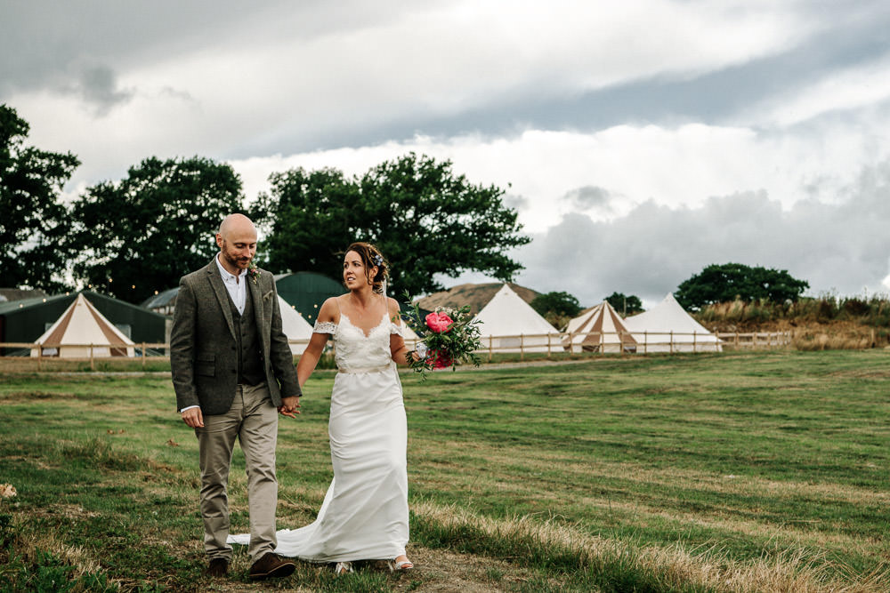 Bride Bridal Dress Gown Lace Detail Drop Cold Shoulder Ribbon Bow Sleeveless Tweed Suit Waistcoat Groom Floral Veil Bouquet Stanford Farm Wedding Andy Griffiths Photography